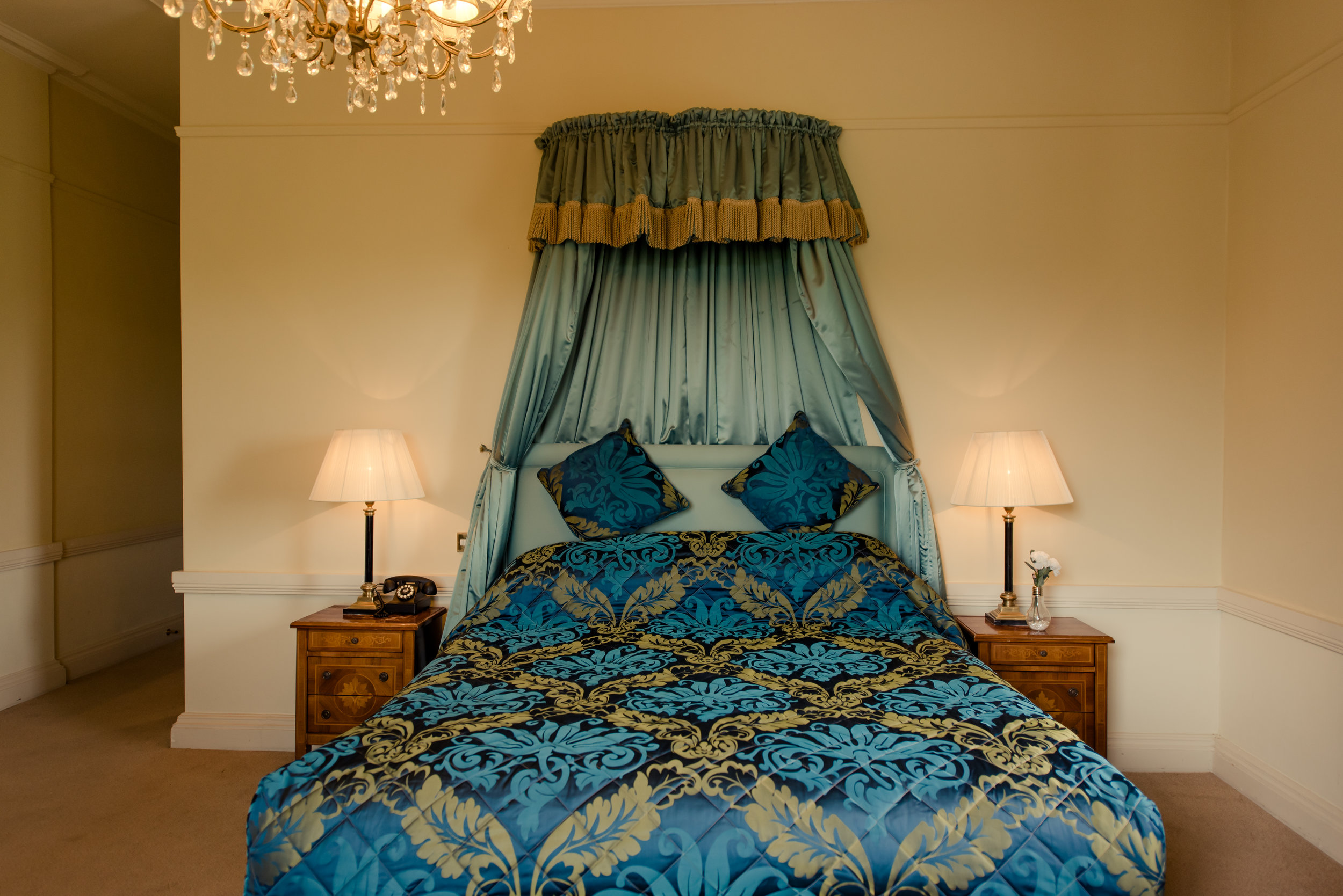Tulfarris Hotel & Golf Resort Manor House bedroom with bedside lockers and lamps.jpg