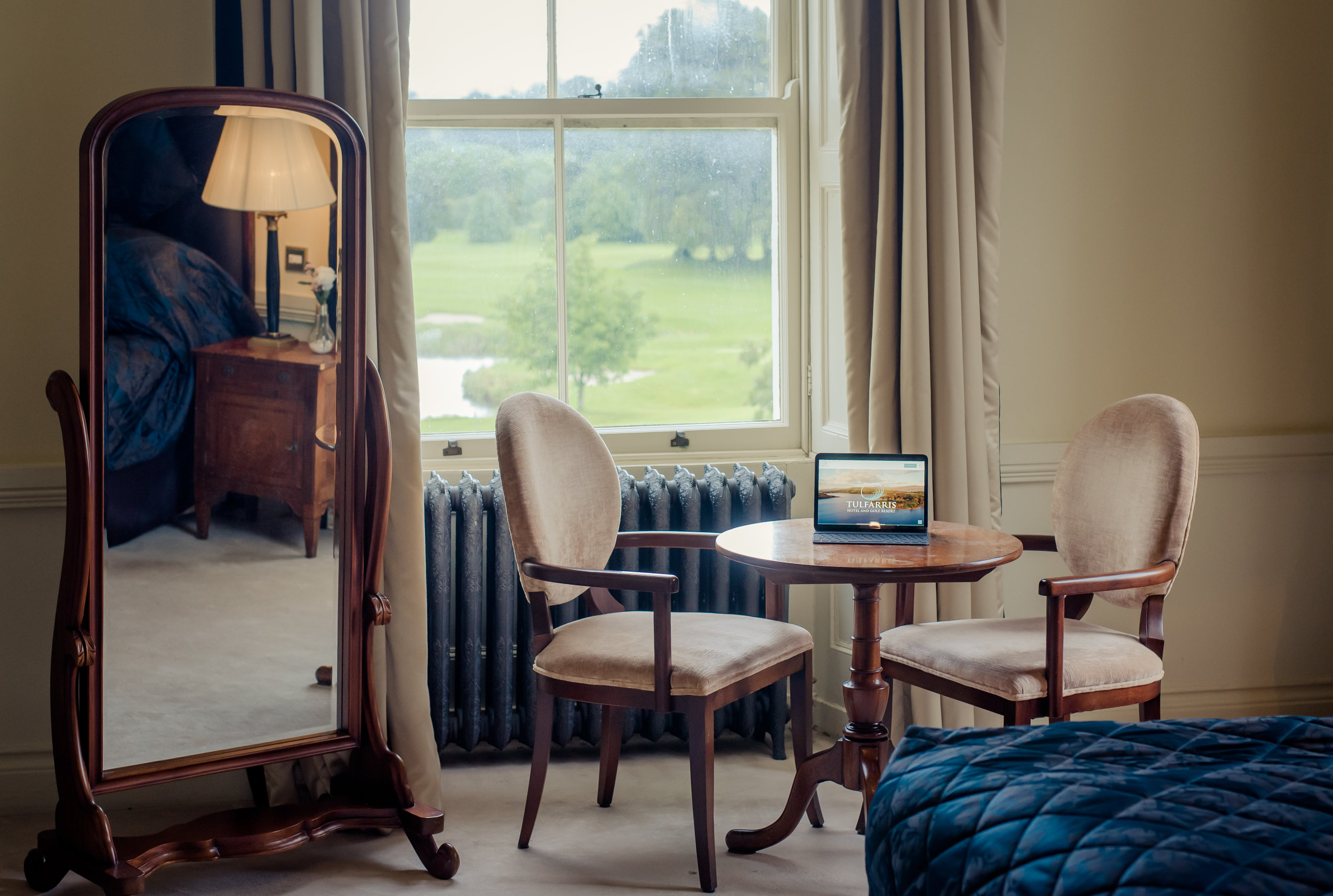 Tulfarris Hotel & Golf Resort Manor House bedroom with iPad on bedise table and chairs.jpg