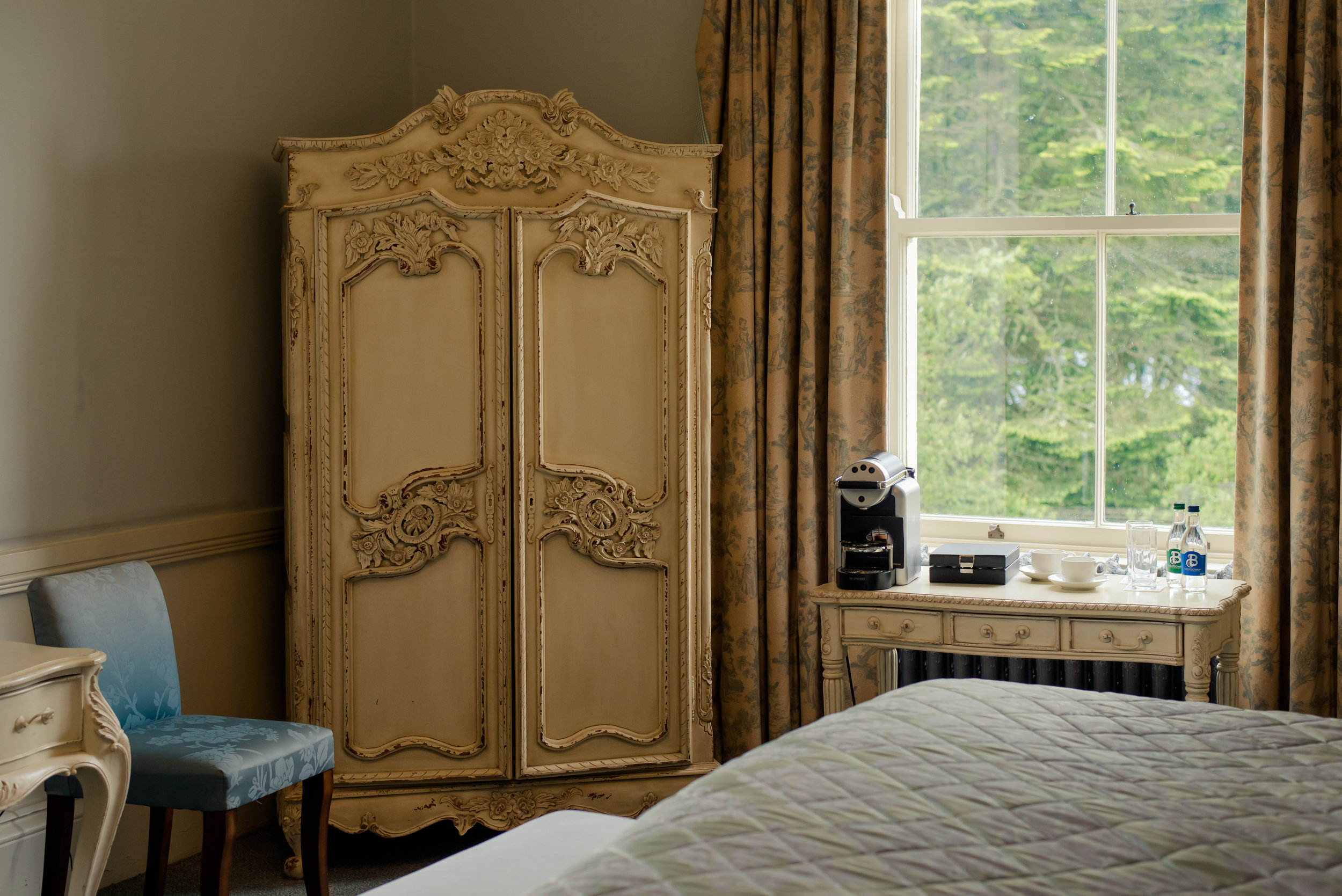 Tulfarris Hotel & Golf Resort Manor House bedroom with cupboard and coffee machine.jpg