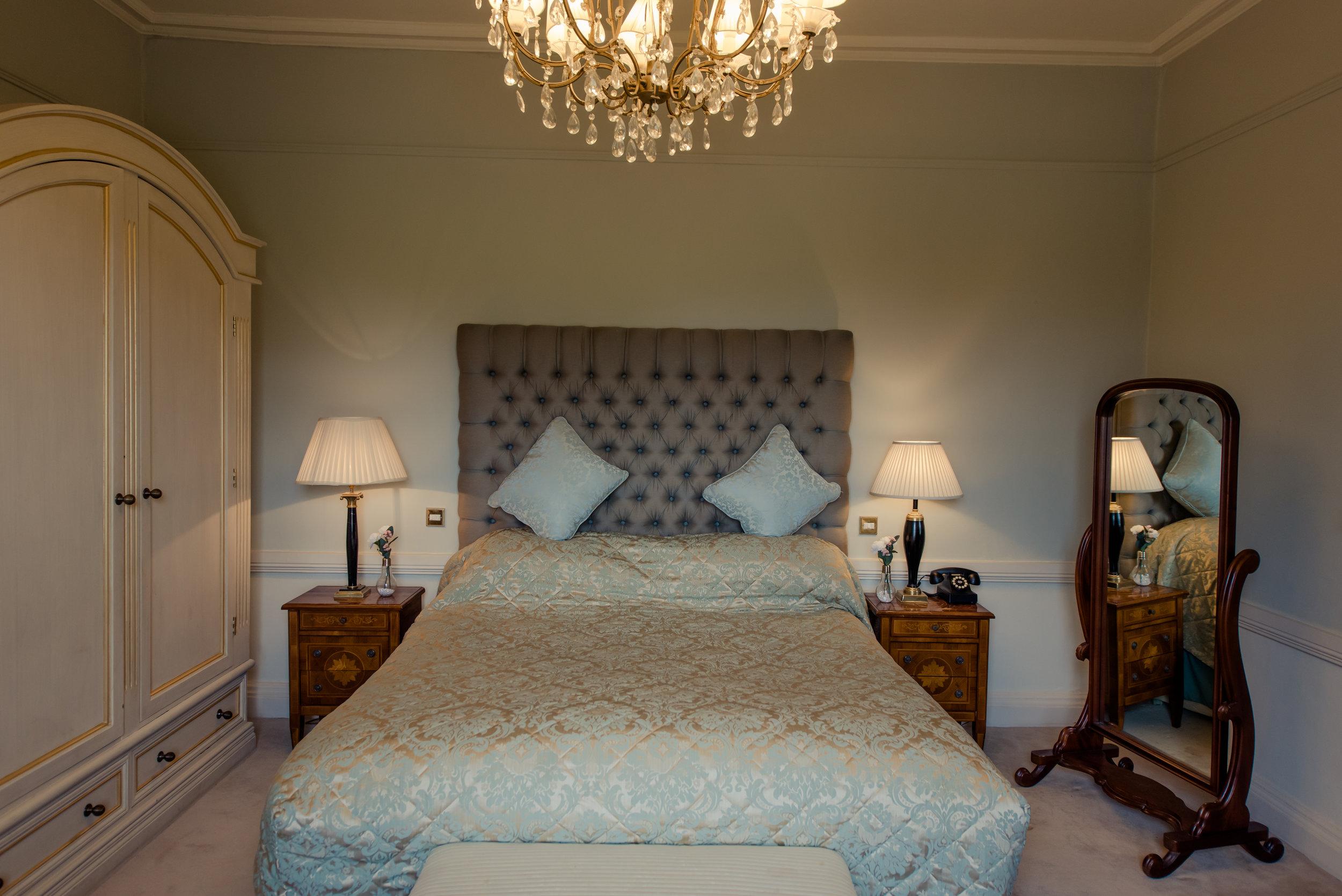 Tulfarris Hotel & Golf Resort Manor House bedroom with large wardrobe.jpg