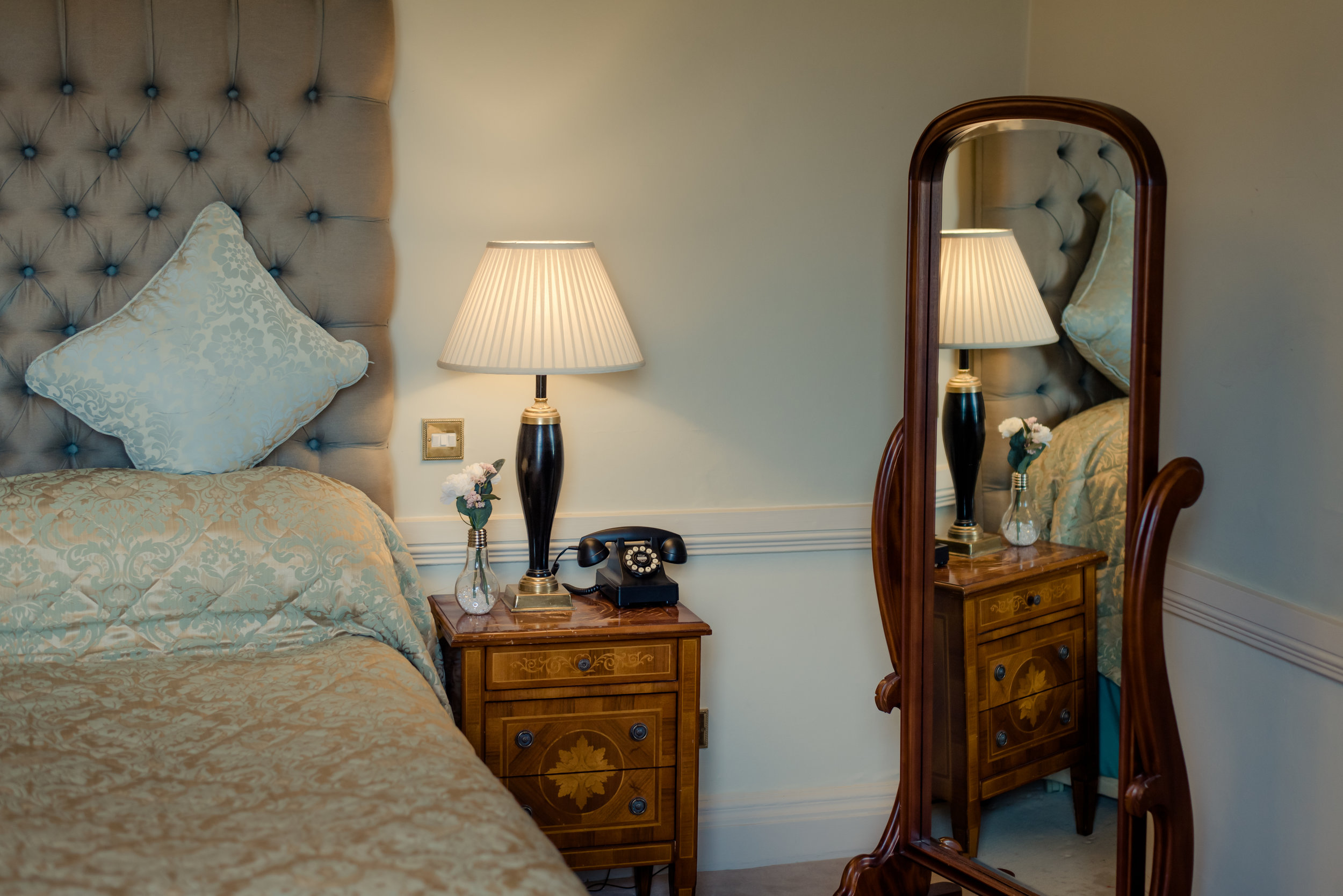 Tulfarris Hotel & Golf Resort Manor House bedside locker and mirror view.jpg