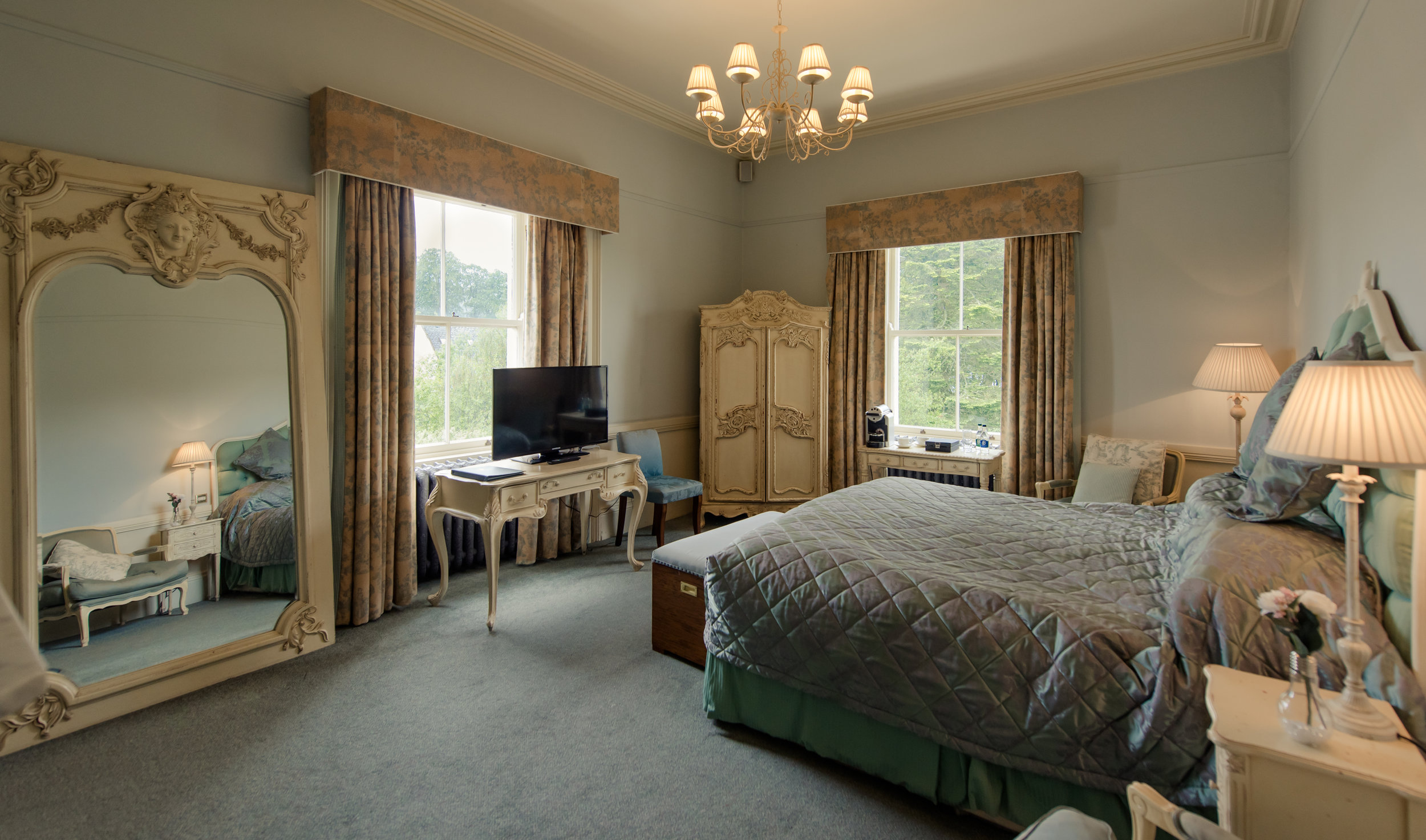 Tulfarris Hotel & Golf Resort Manor House large luxurious bedroom with large mirror.jpg