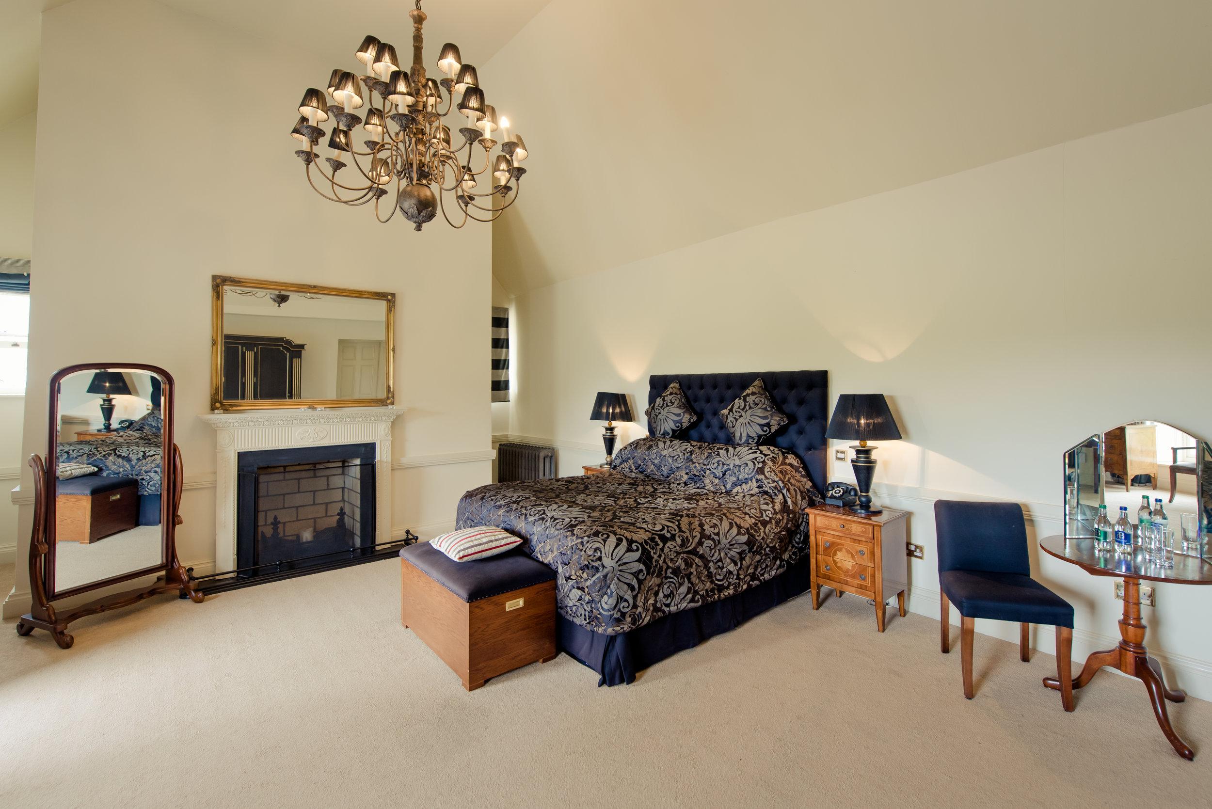 Tulfarris Hotel & Golf Resort Manor House luxurious bedroom with chandelier.jpg