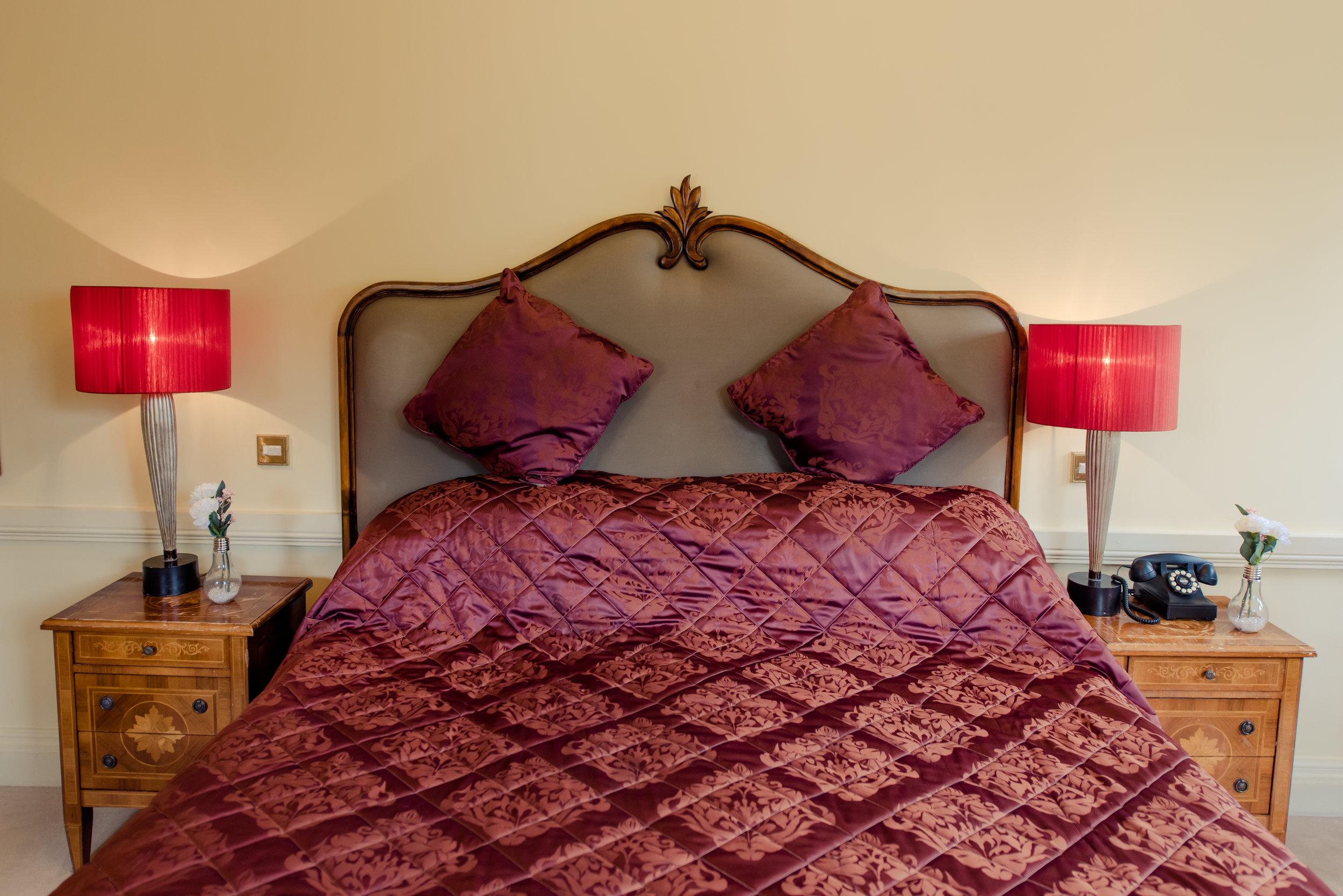Tulfarris Hotel & Golf Resort Manor House red setting bedroom.jpg