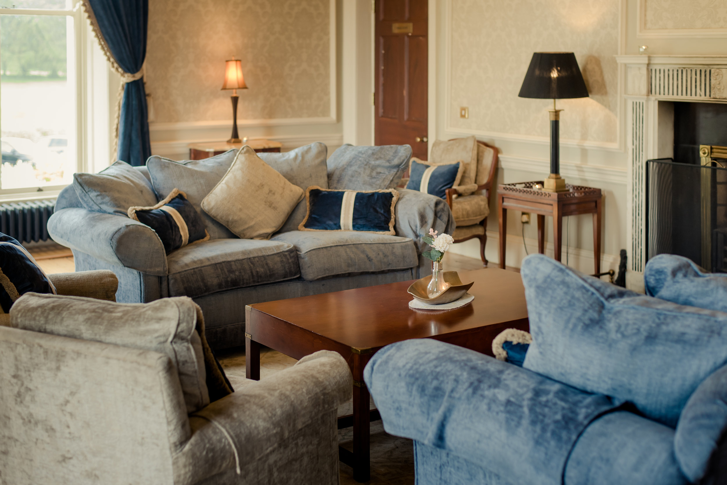 Tulfarris Hotel & Golf Resort Manor House seating by the fireplace.jpg