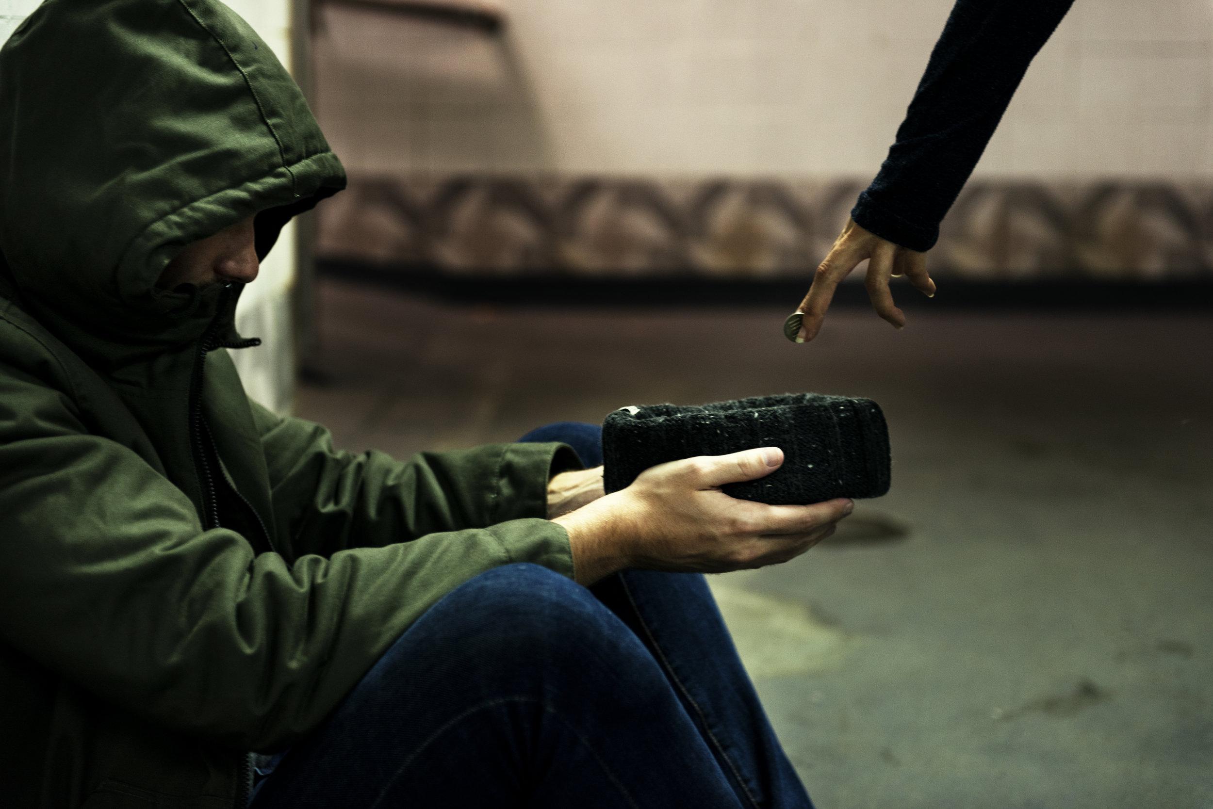 homeless-beggar-man-holding-hat-asking-for-money-PHLPNJL.jpg