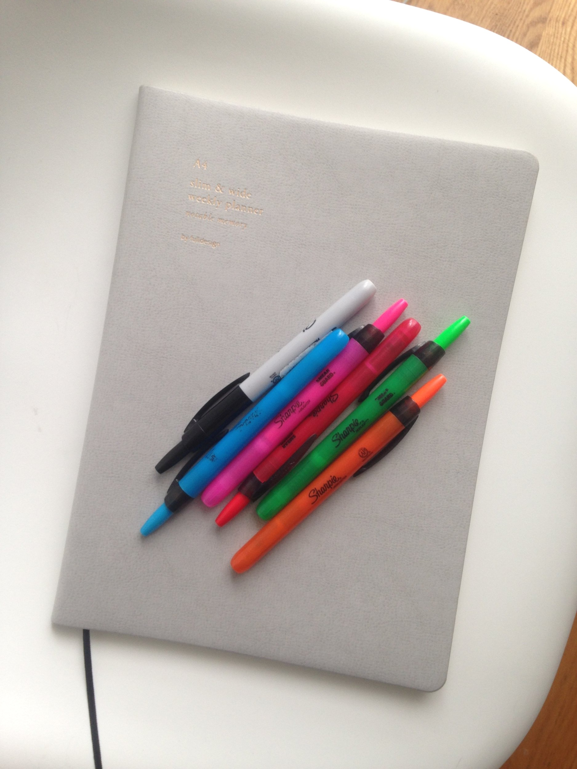 Planner, highlighters, and fancy pens