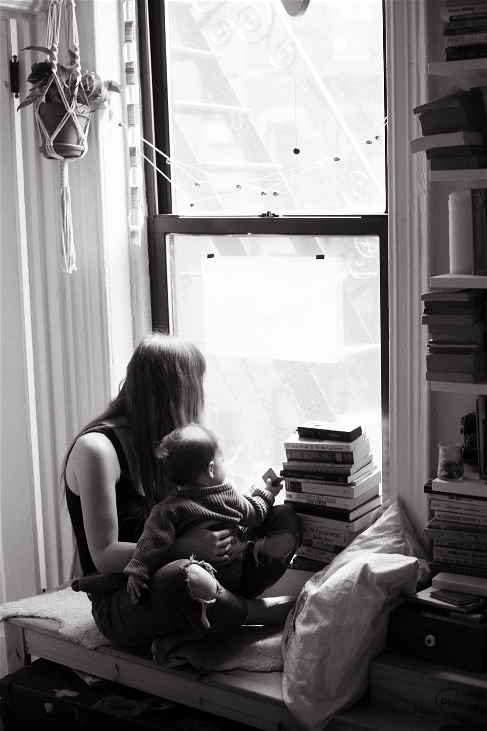 baby and mother in a window new york city family photographer