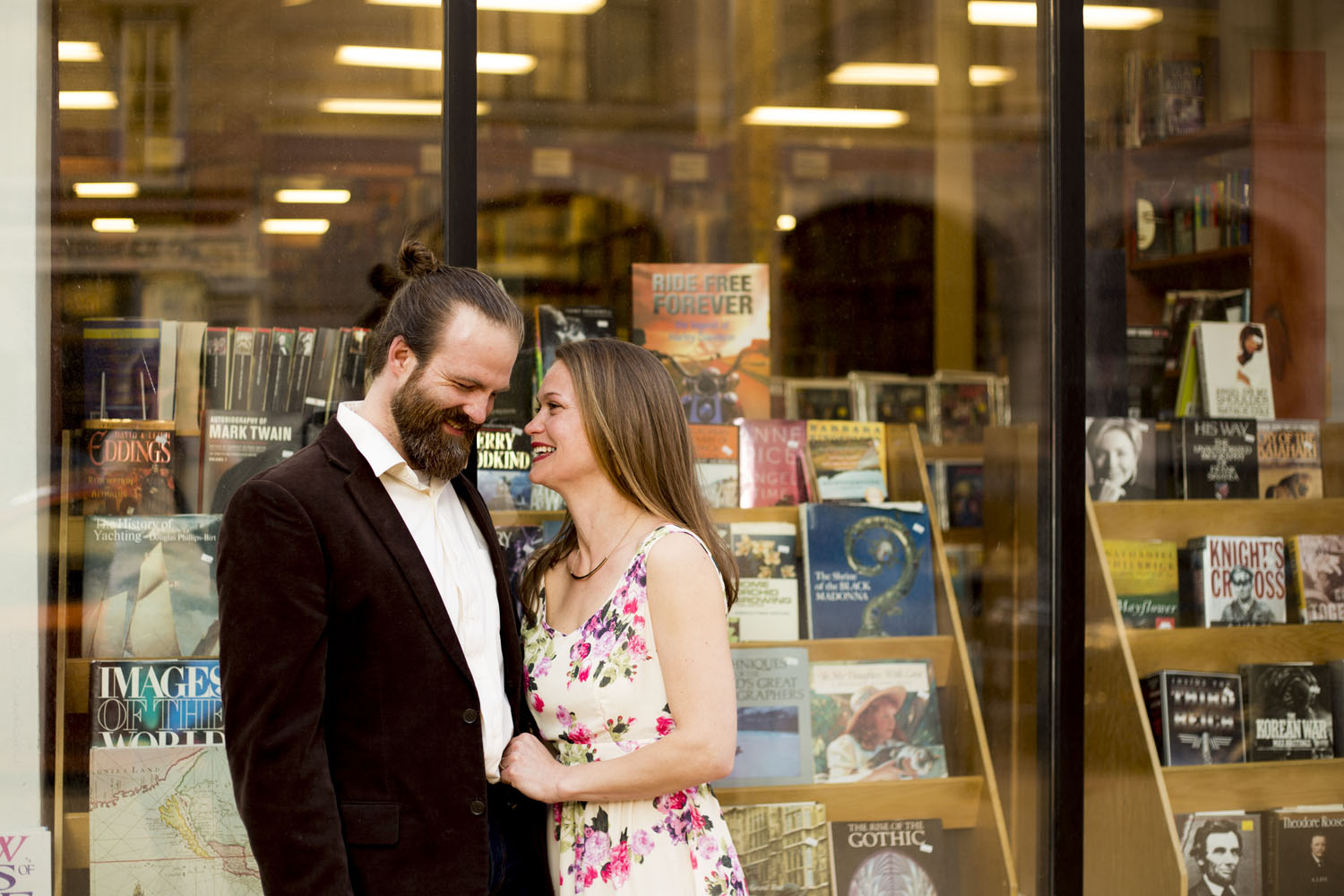 bookstore couple laughing anniversary session