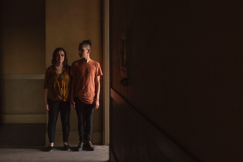 abandoned building couple standing dark moody photographer
