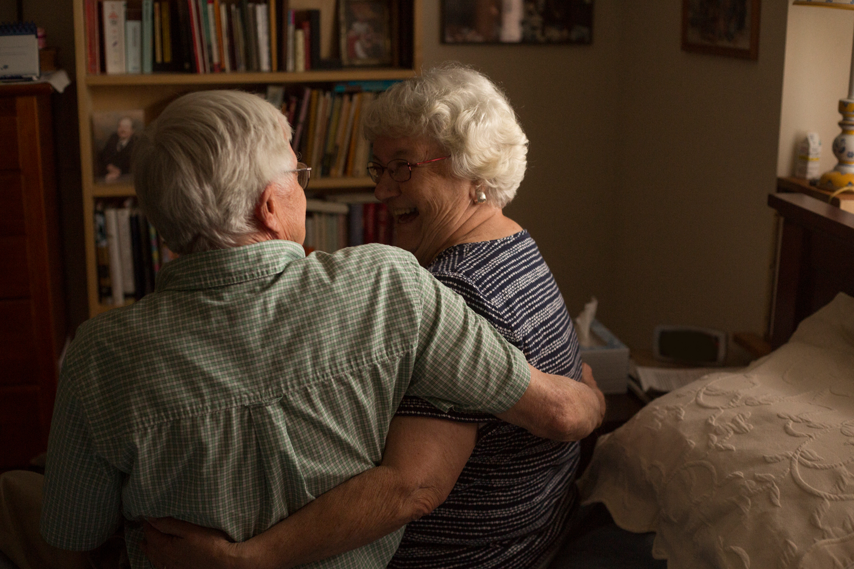 grandparents hugging in home portrait session