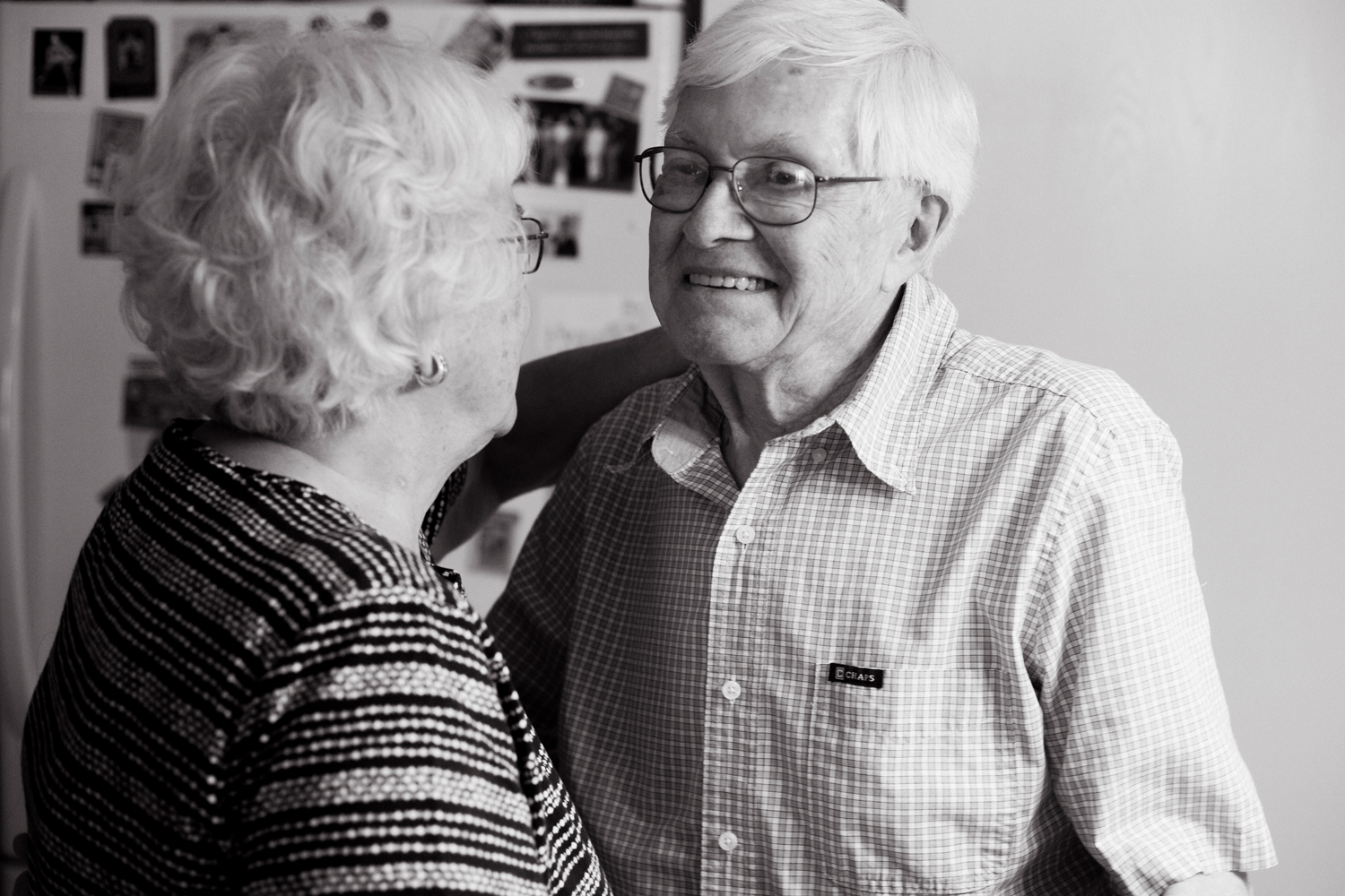grandpa smiling dancing with his wife