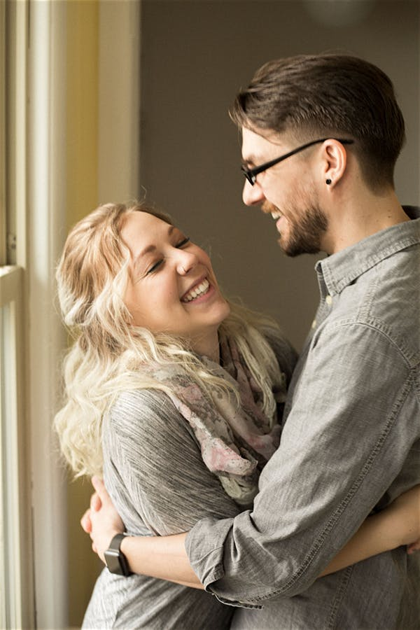 couple hugging and laughing in home shoot