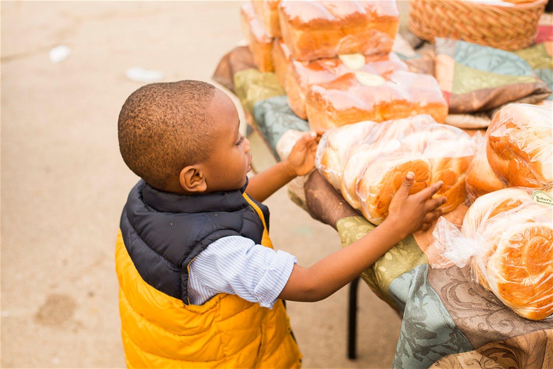 family photographer new york city kid holding bread