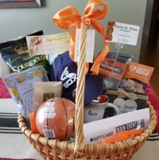 "This basket was completed by Christina's Team. Special thanks to Lara and Daniela for helping with this ACT. It was filled with all sorts of thoughtful and encouraging items, goodies to eat, activities for the family and other needed items for a family of 4 whose father is healing and rehabilitating from surgery for Grade IV Glioblastoma(brain tumor).  What is super sweet about this ACT, is that the recipient is ""paying it forward"" by nominating a woman and her family who is battling the same challenge.  We are currently working on that RAM Basket.  This is one of our RAM HOPES,  that people will pass KINDNESS on by nominating others in need of compassion."