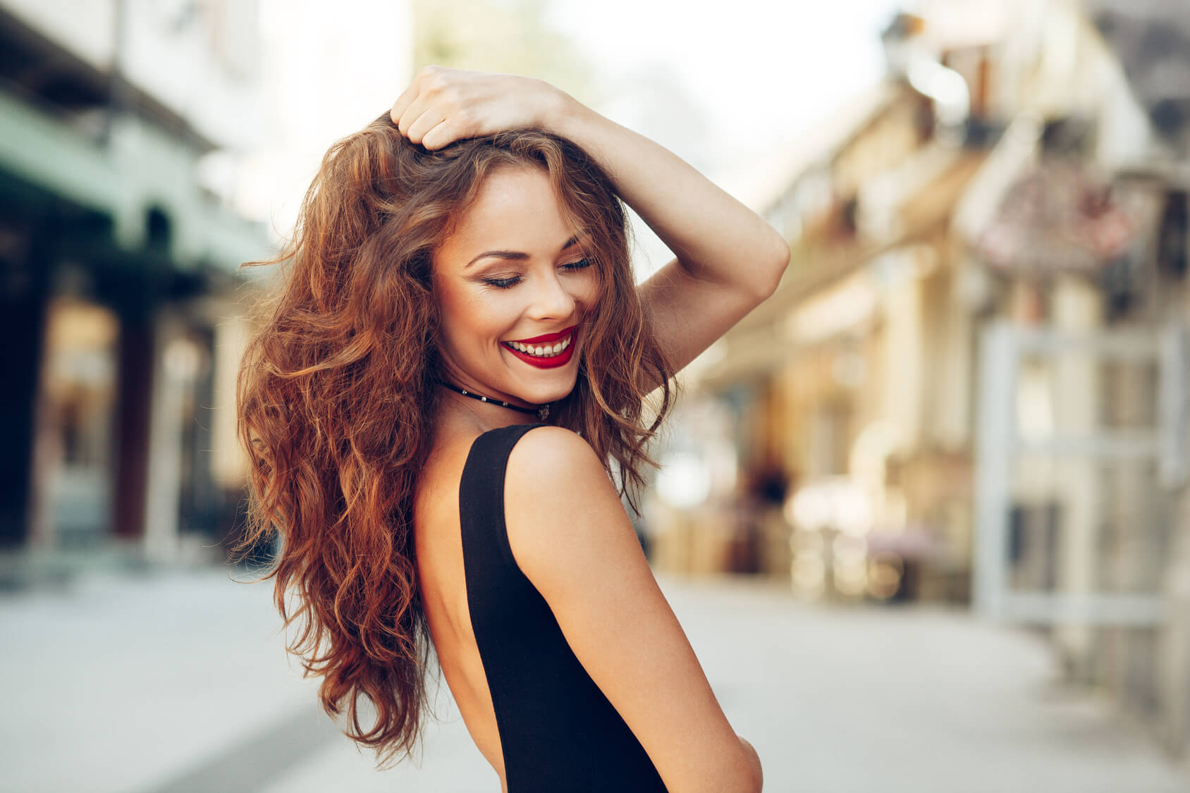 Attractive lady happy with dental veneers