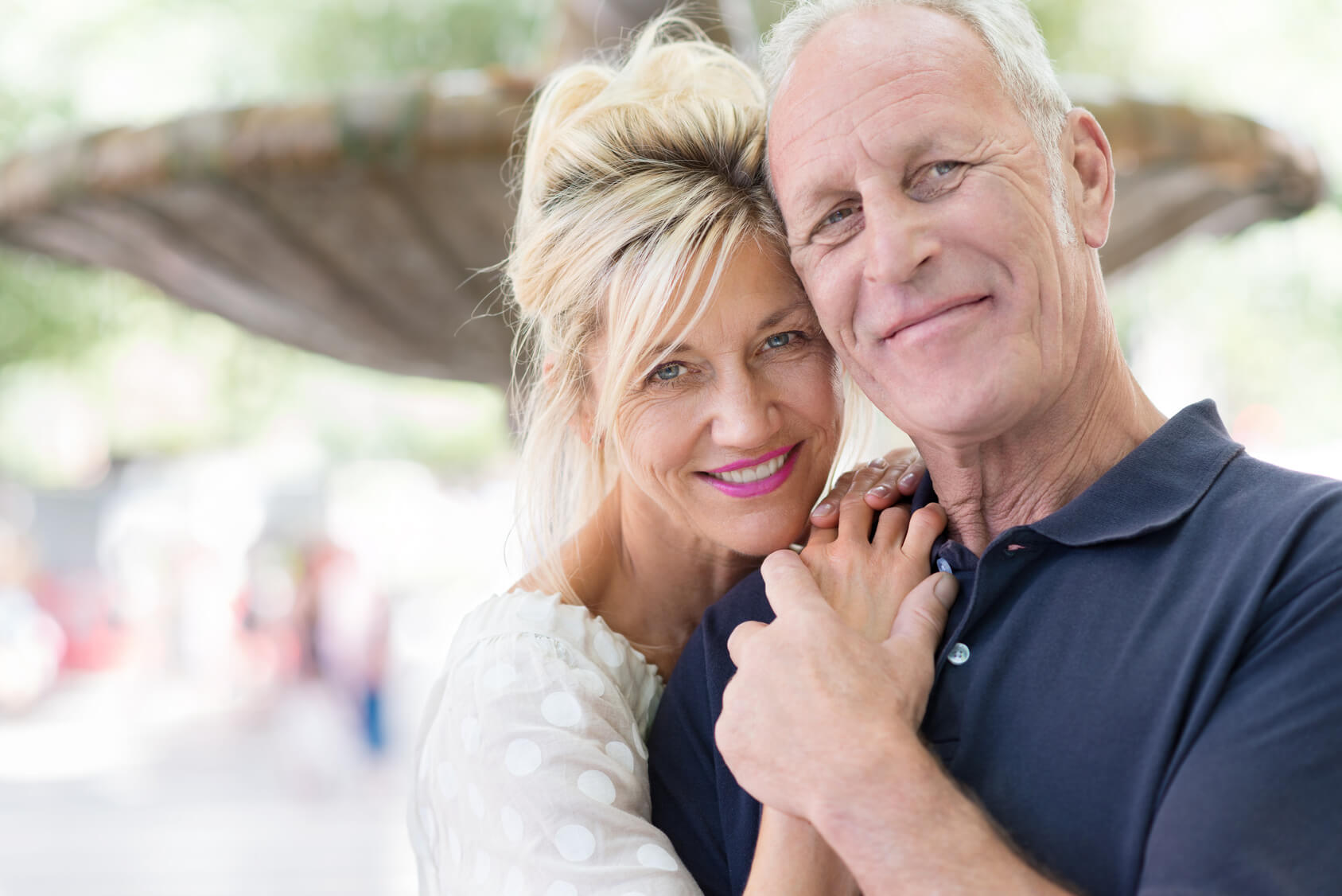 Older couple happy after replacing their missing teeth with dental implants