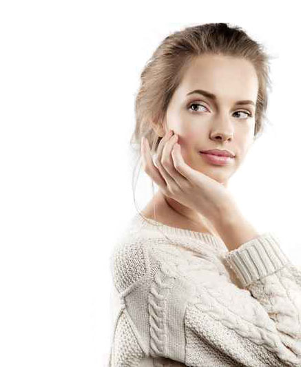 Attractive lady holding face after facial aesthetics at Surrey Dental Surgery