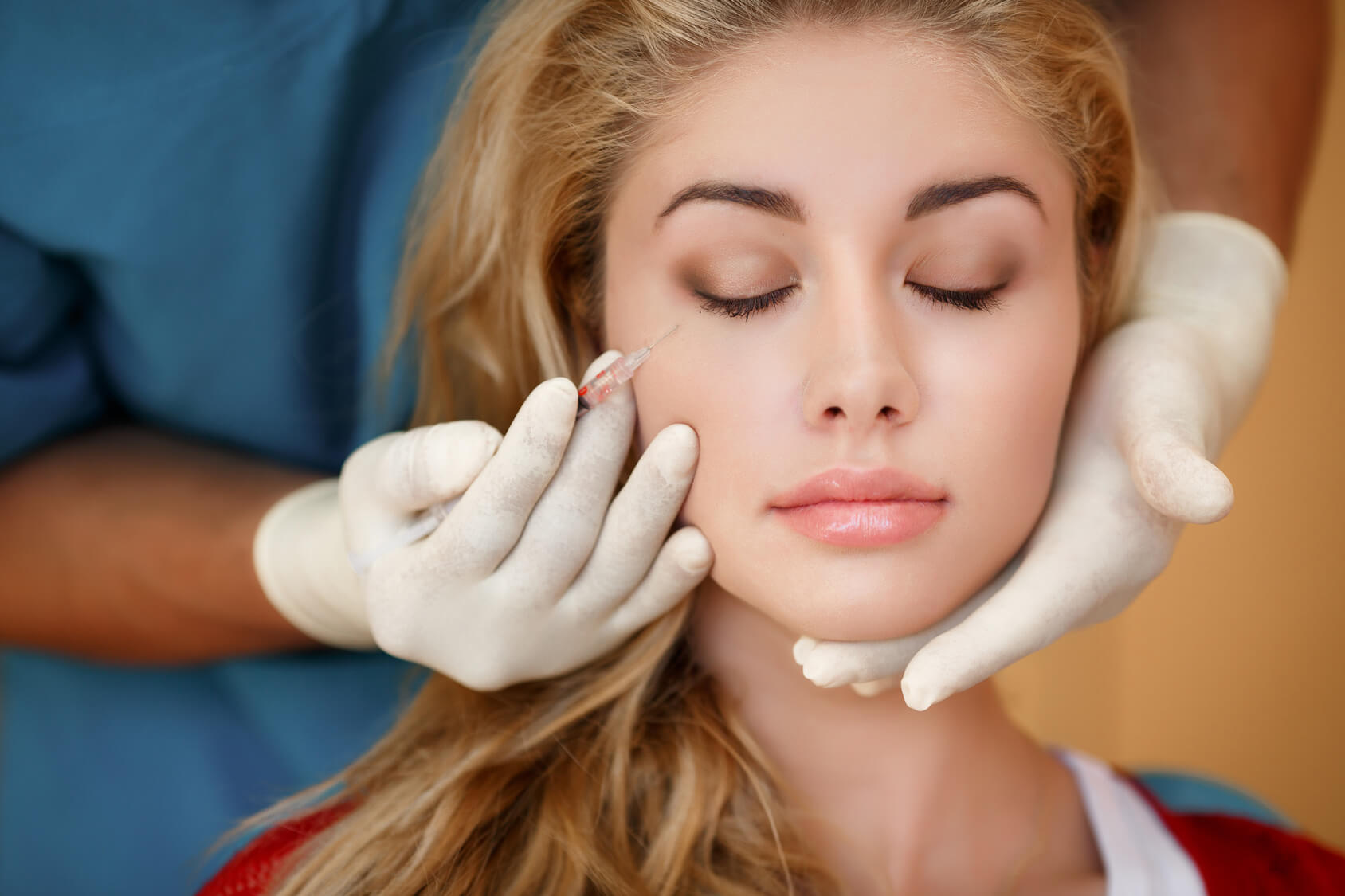 Lady having Botox injection at the dentist