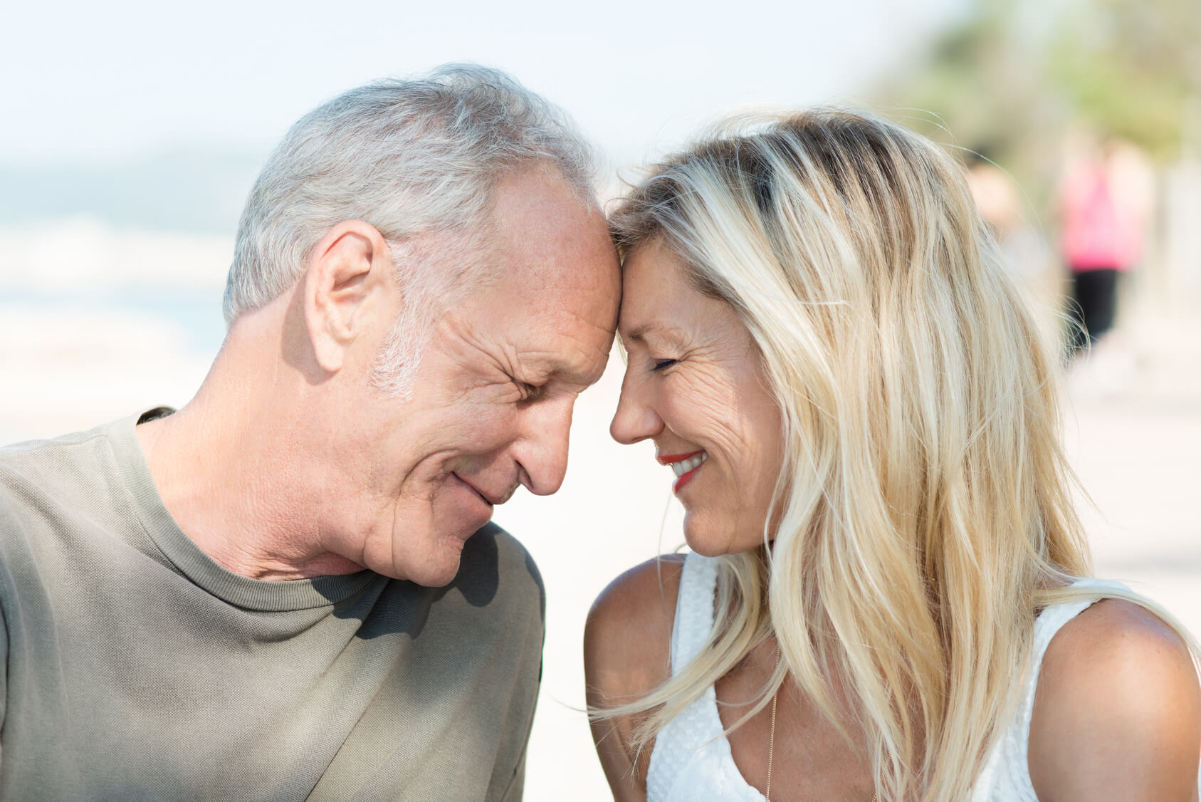 Older couple looking happy after dental crowns