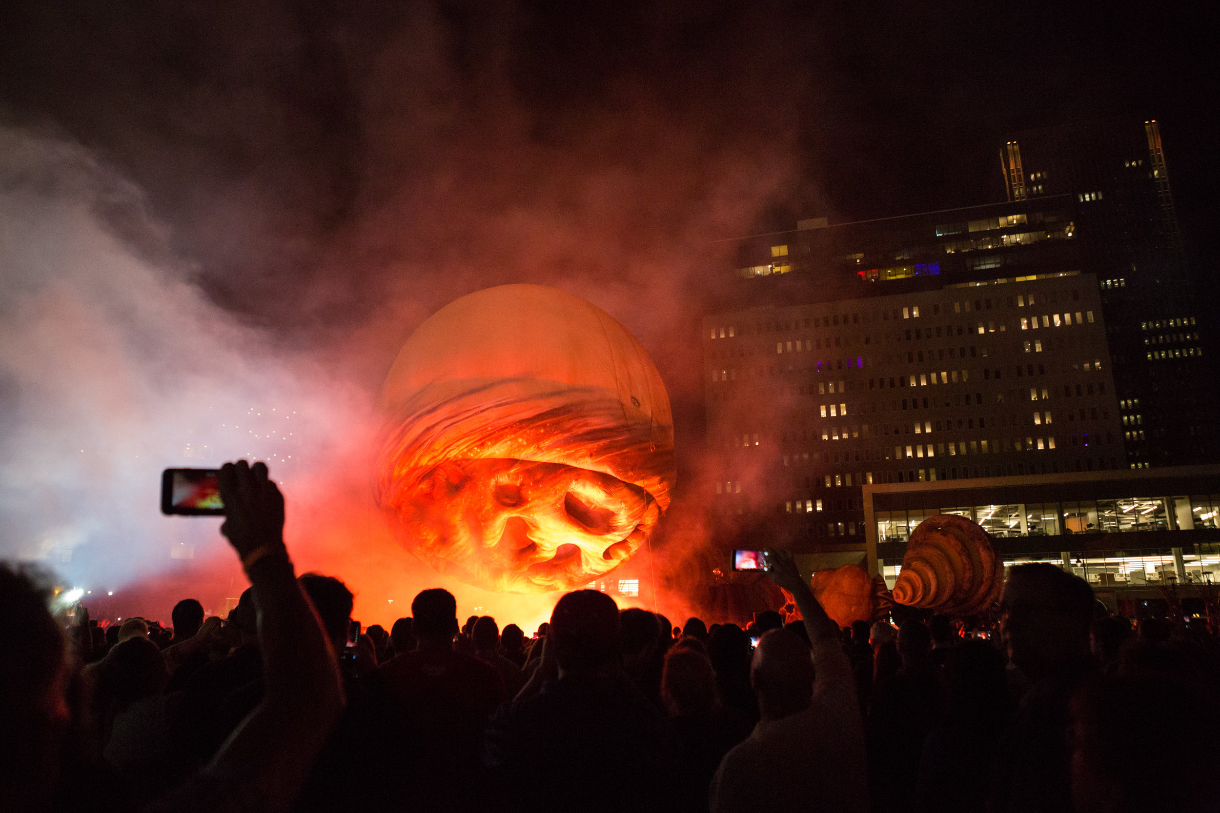 """Plasticiens Volants performs """"Big Bang"""" for a crowd in Rochester, N.Y. as part of the Key Bank Rochester Fringe Festival. Plasticiens Volants is a French performance group that uses lights, music, and giant flying balloons to dazzle audiences around the world."""