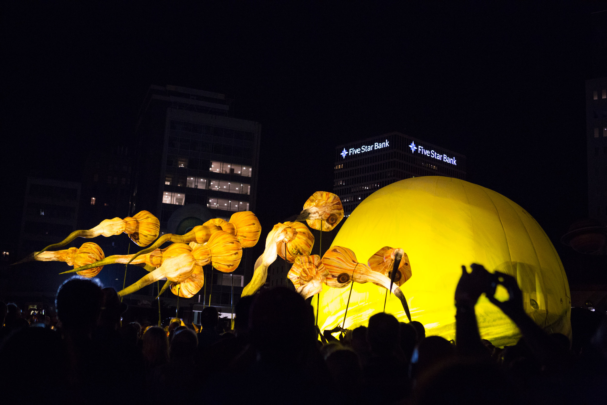 Plasticiens Volants brings their inflatables into the crowd as part of the performance. Participants are encouraged to touch and interact with the balloons.