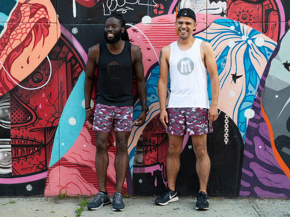 Models are wearing the Run Brooklyn WilyB 5in Short in Burgundy Camo and Black