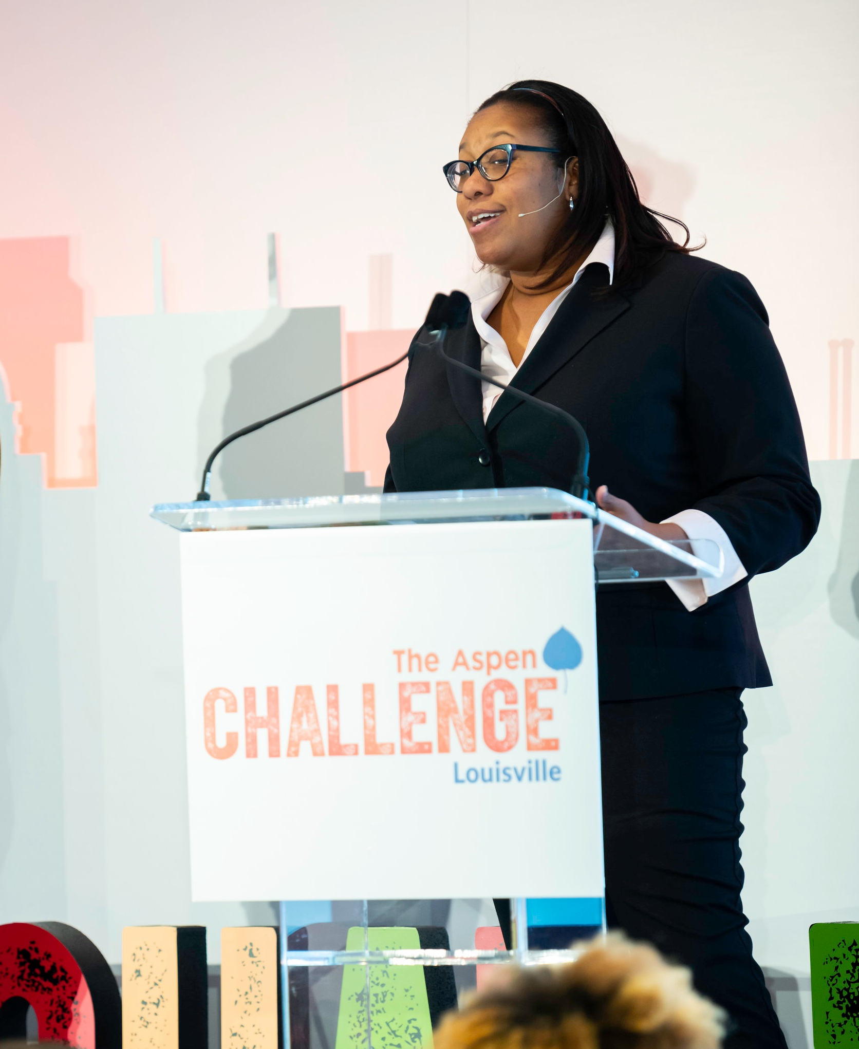 Tigee Hill presents her challenge at Louisville Opening Forum