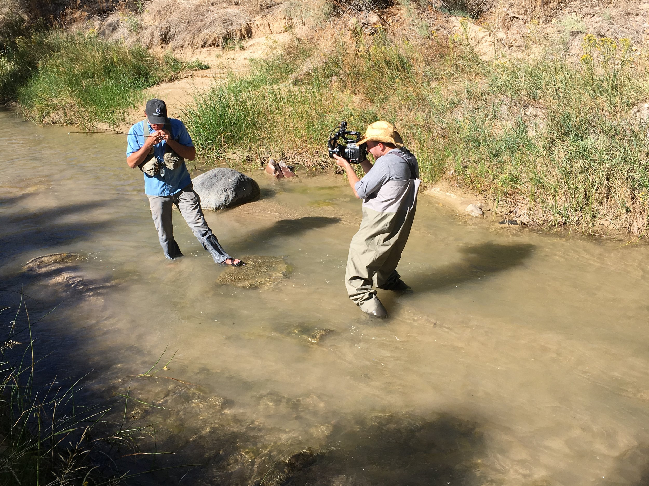 Knee deep in the Escalante river, DP Mark Barry gets the shot wearing a borrowed directors hat and waders to protect from the elements.