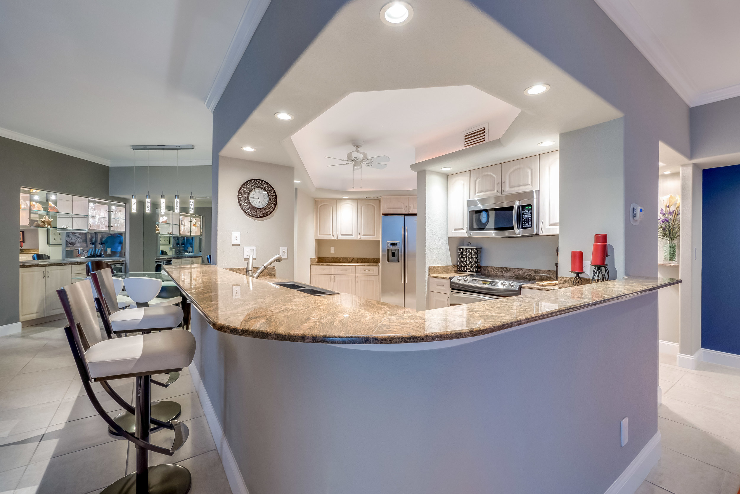 Gorgeous granite, stainless steel appliances, and bar are features of the beautiful kitchen.