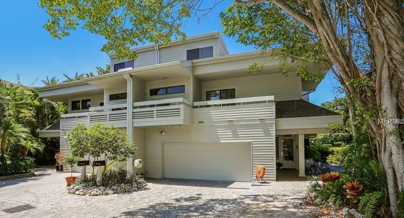 Located right on Sarasota Bay with deepwater dockage for your boat, this charming and updated townhome makes a great vacation, seasonal, or permanent home.