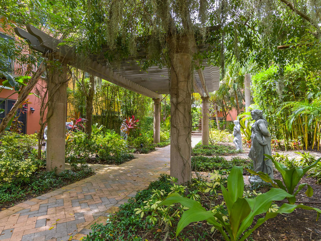 The garden courtyard is complete with beautiful statues and pergolas set in the scenic space.