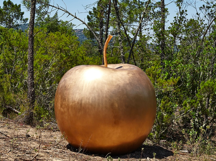 Claude Lalanne's oversized bronze apple,  Pomme de New York  at Domaine du Muy in the South of France. © Claude Lalanne. Courtesy Domaine du Muy. Photograph: JC Lett.