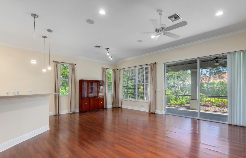 """BEFORE: Another undefined """"great room"""" that is difficult to picture actually living in. And you really notice the not-amazing dining room light fixture since there is not much else to draw attention."""