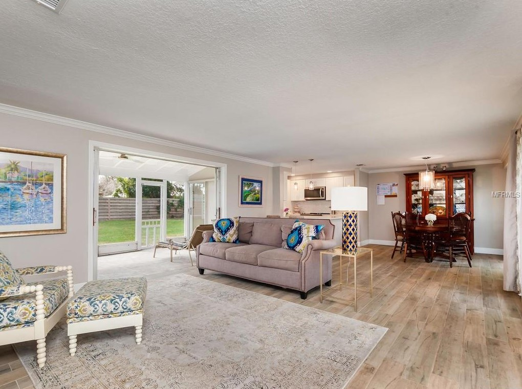 AFTER: Same area, but with a clear living room and dining room that makes the space make sense and adds some fun color.
