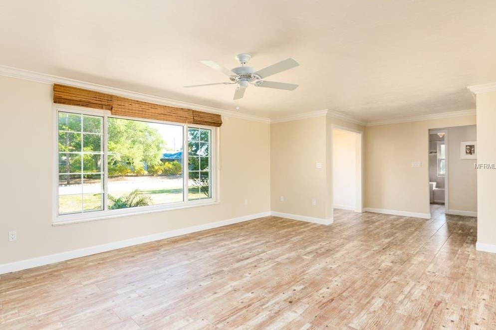 BEFORE: What to do with this living room?? Where does the sofa go?? Does it have to float??? And is the foyer a waste of space?!