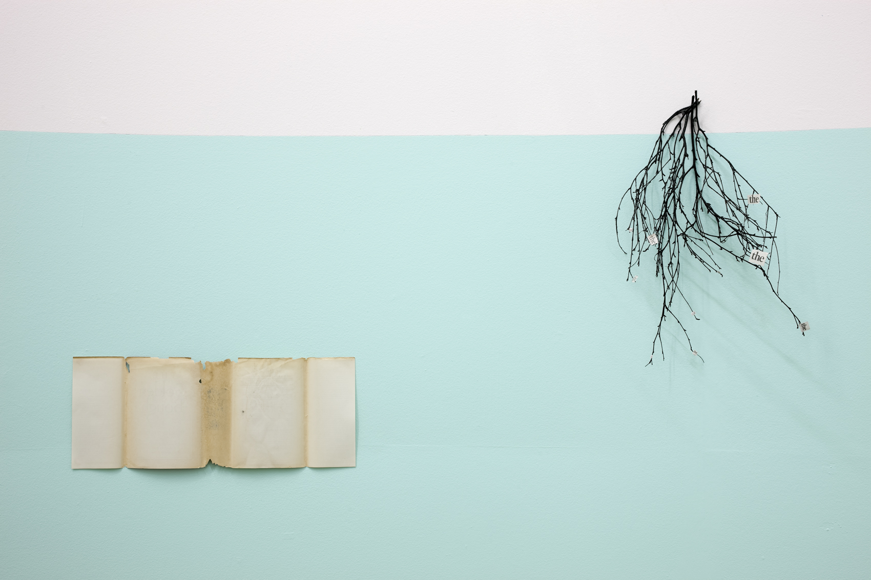 The Golden Bough ( left:  Book cover  right: T he the) , 2010 .  Book jacket, newspaper, white tack and Indian ink on twigs and painted wall .  Photo Denis Mortell.