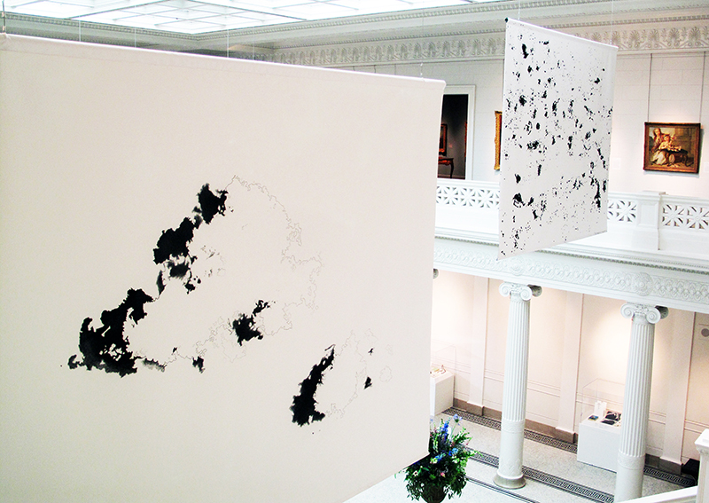 Installation view of the recto sides of from left:  Cloud(s) over Cocodrie Bay (as seen from Google Maps)  and  Constellations (map of Louisiana oil and gas wells),  2012, 10 x 12 feet (each).