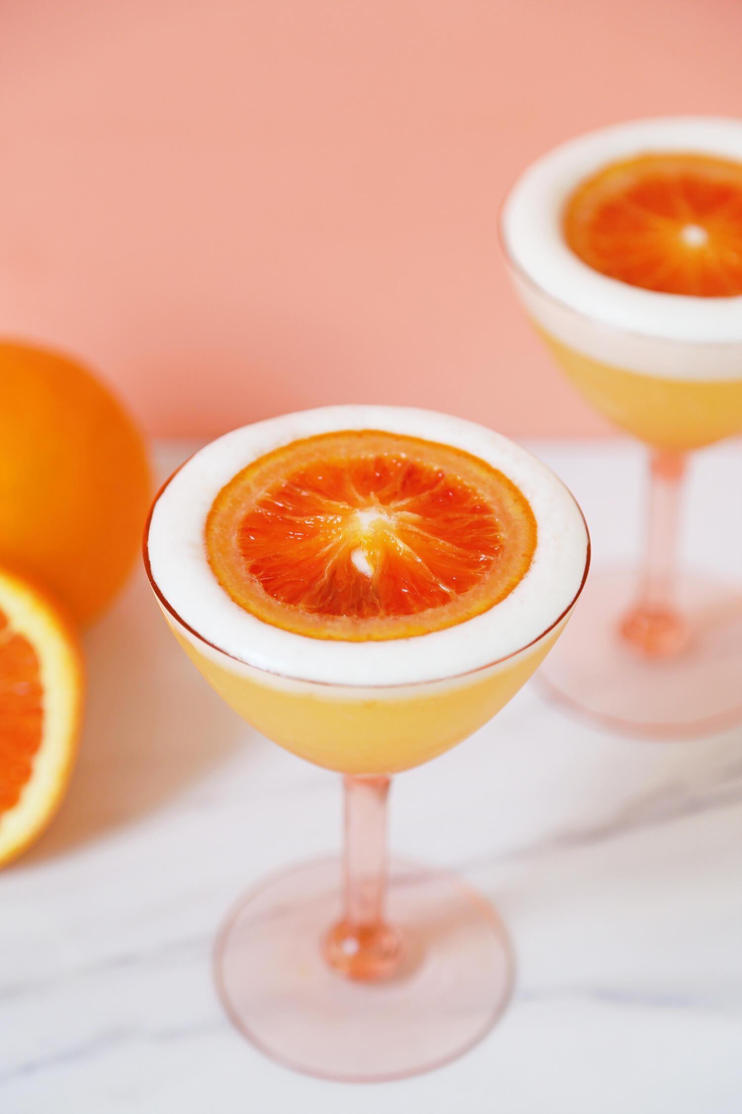 Heavenly, complete with a halo of orange. Gorgeous photo snagged from  http://arsenic-lace.com/cara-cara-mezcal-sour/