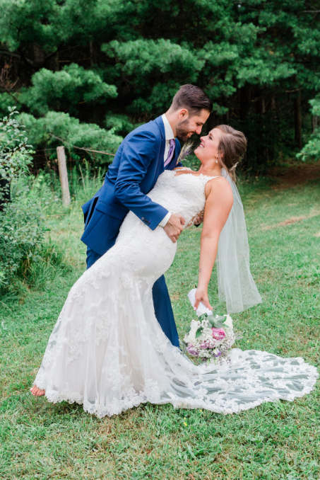 Updated: This is me and my hubs on our wedding day … and I wore the size of dress that fit me on that day. Read on for my wedding dress shopping experience.