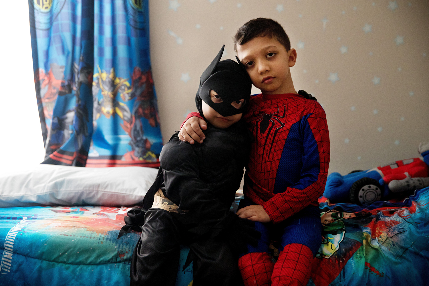 Jahan Adam, 6, left, and Arshaan Adam, 8, pose for a portrait in their favorite superhero costumes. The brothers have an extremely rare disease called Jansen's metaphyseal chondrodysplasia, which affects the bones and is caused by a genetic mutation. Though not terminal, the diagnosis means chronic pain and multiple surgeries to straighten weak bones. The disease also can lead to kidney problems, caused by the high levels of calcium in the bloodstream