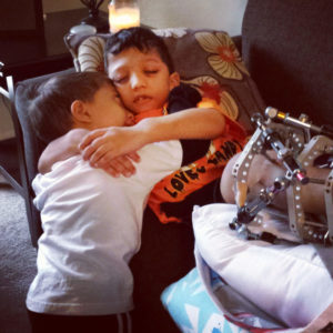 Jahan comforting his older brother, Arshaan