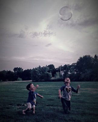 The Adam boys playing with bubbles