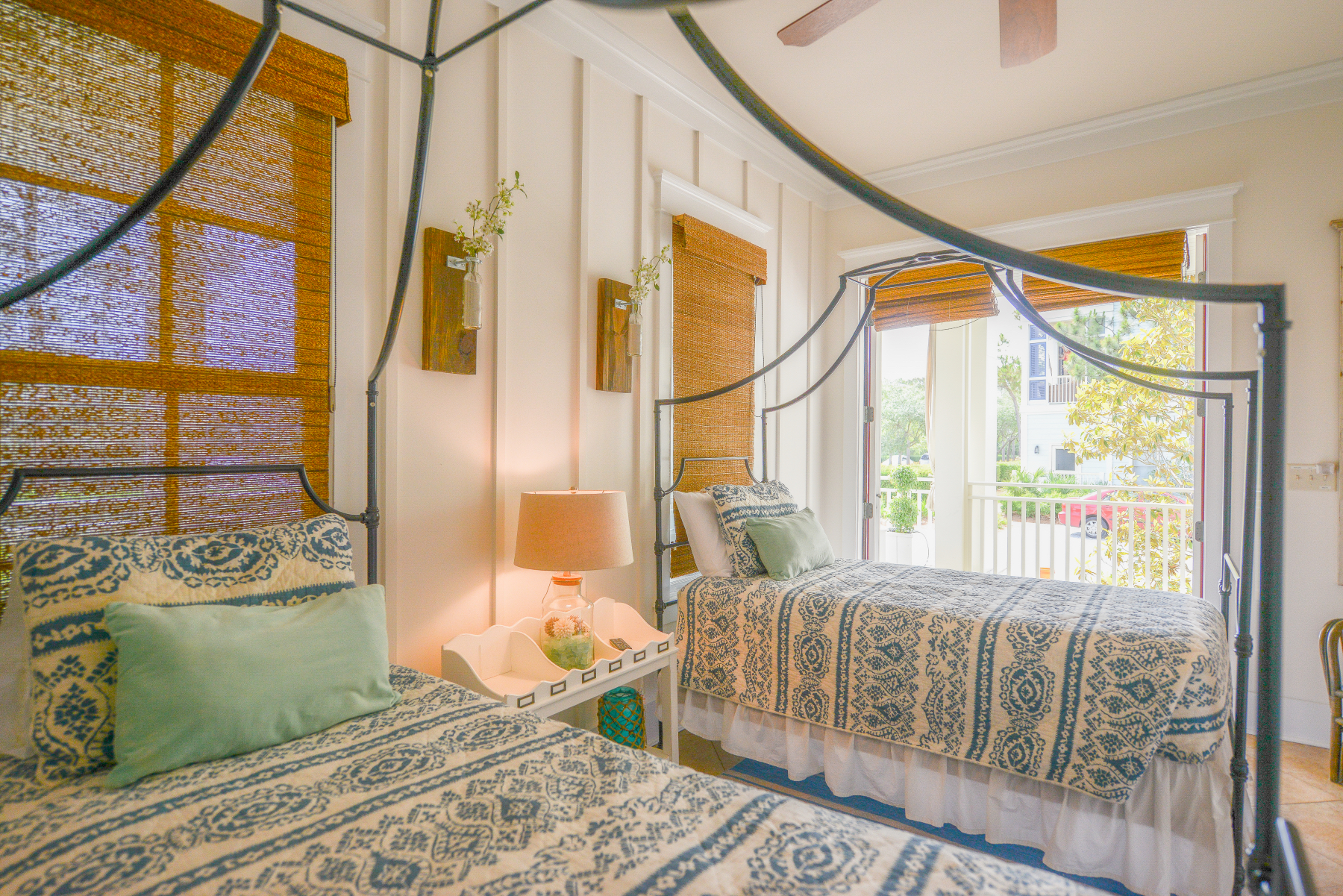 Watercolor florida beach house twin canopy bed.jpeg