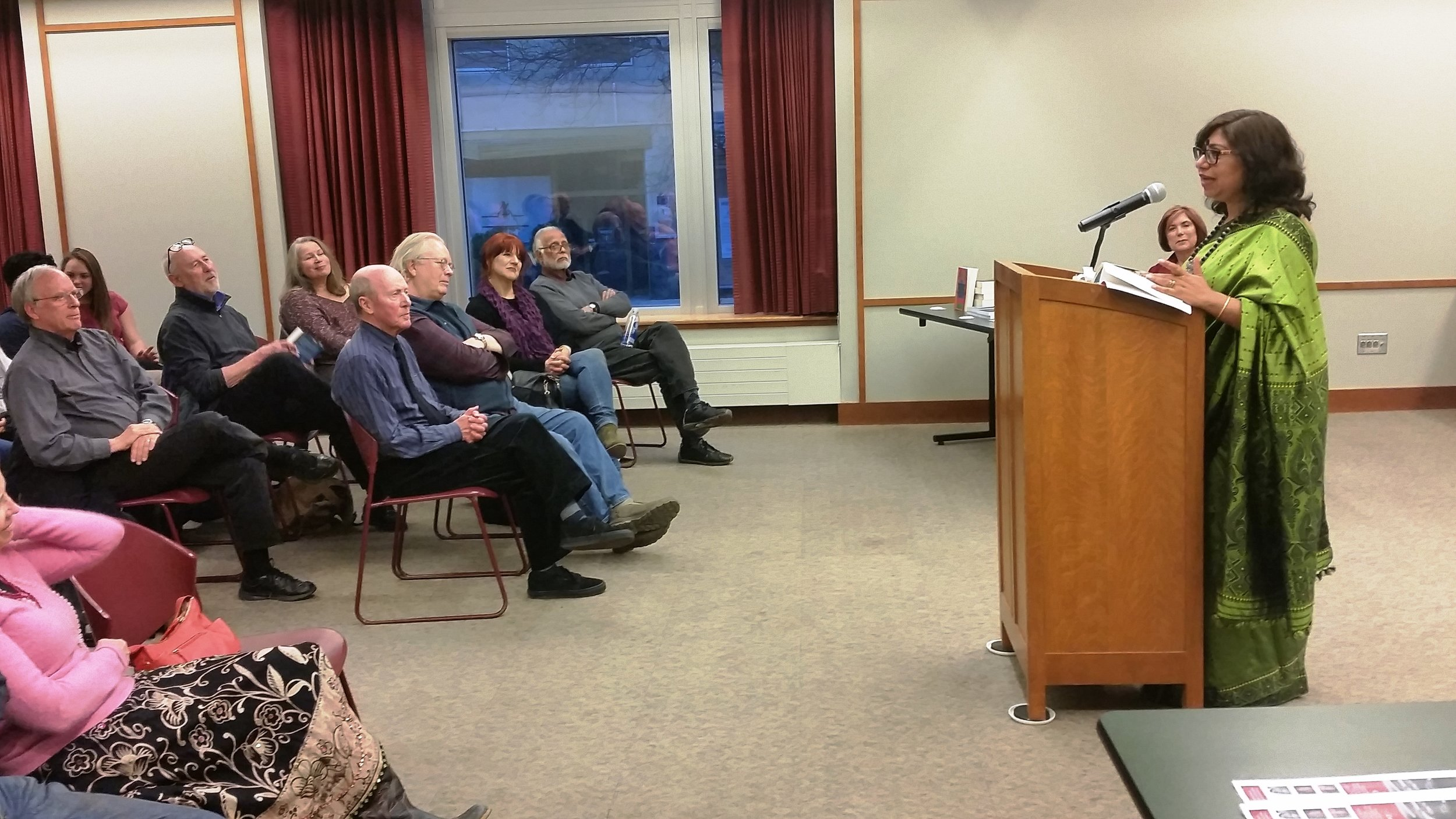 Dipika Mukherjee reads from the Chicago Quarterly Review at Evanston Public Library. (Photo by Russell Johnson.)