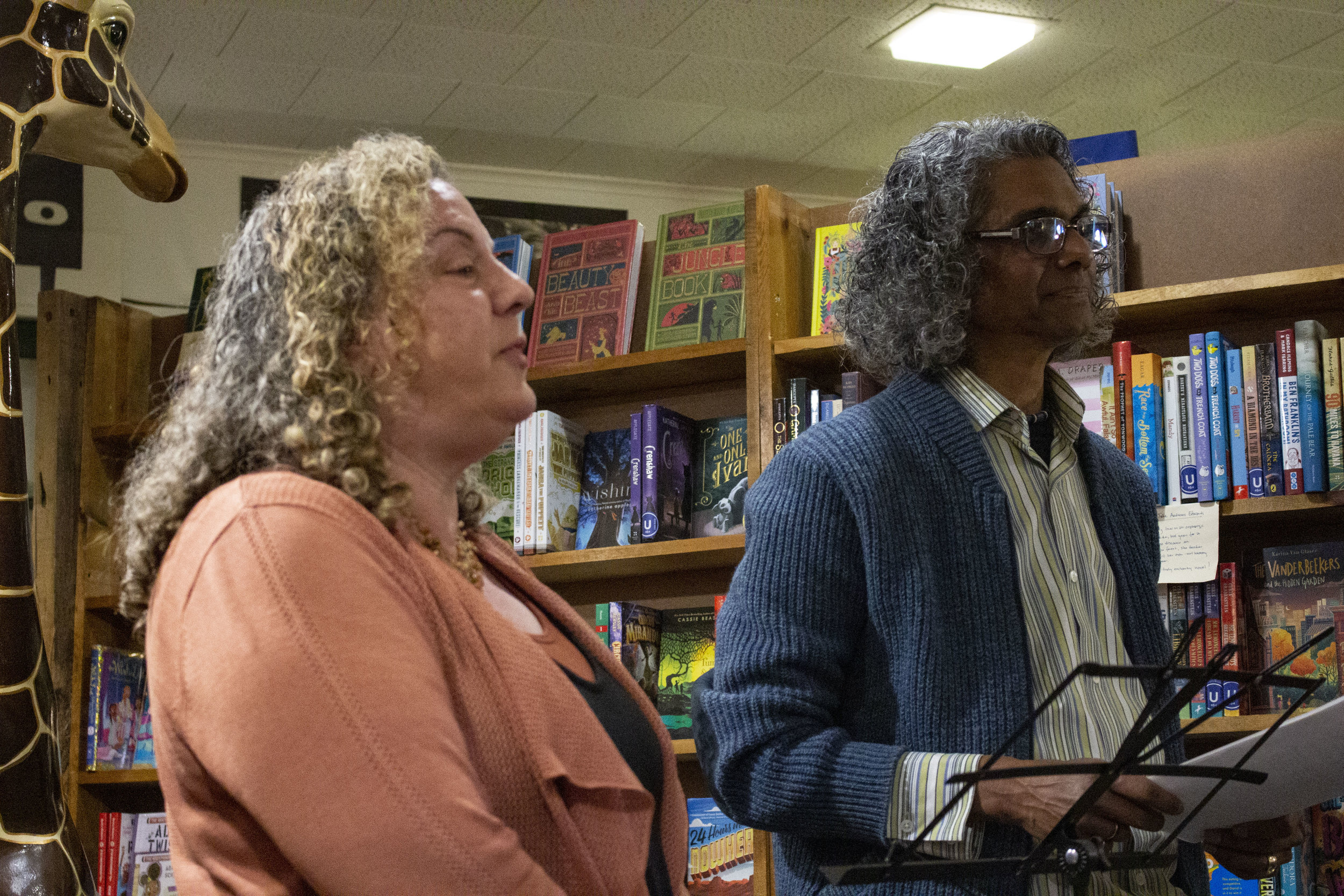 Celebrating Evanston Voices organizers Dina Elenbogen and Ignatius Valentine Aloysius introduce the reading at Bookends & Beginnings.