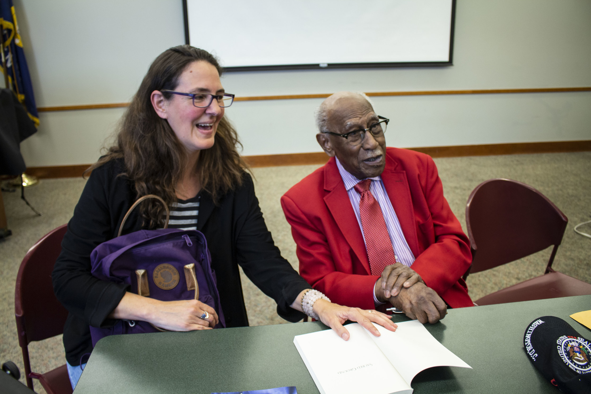 Jane Bunker, Director of Northwestern University Press, with author Timuel Black at Evanston Public Library.