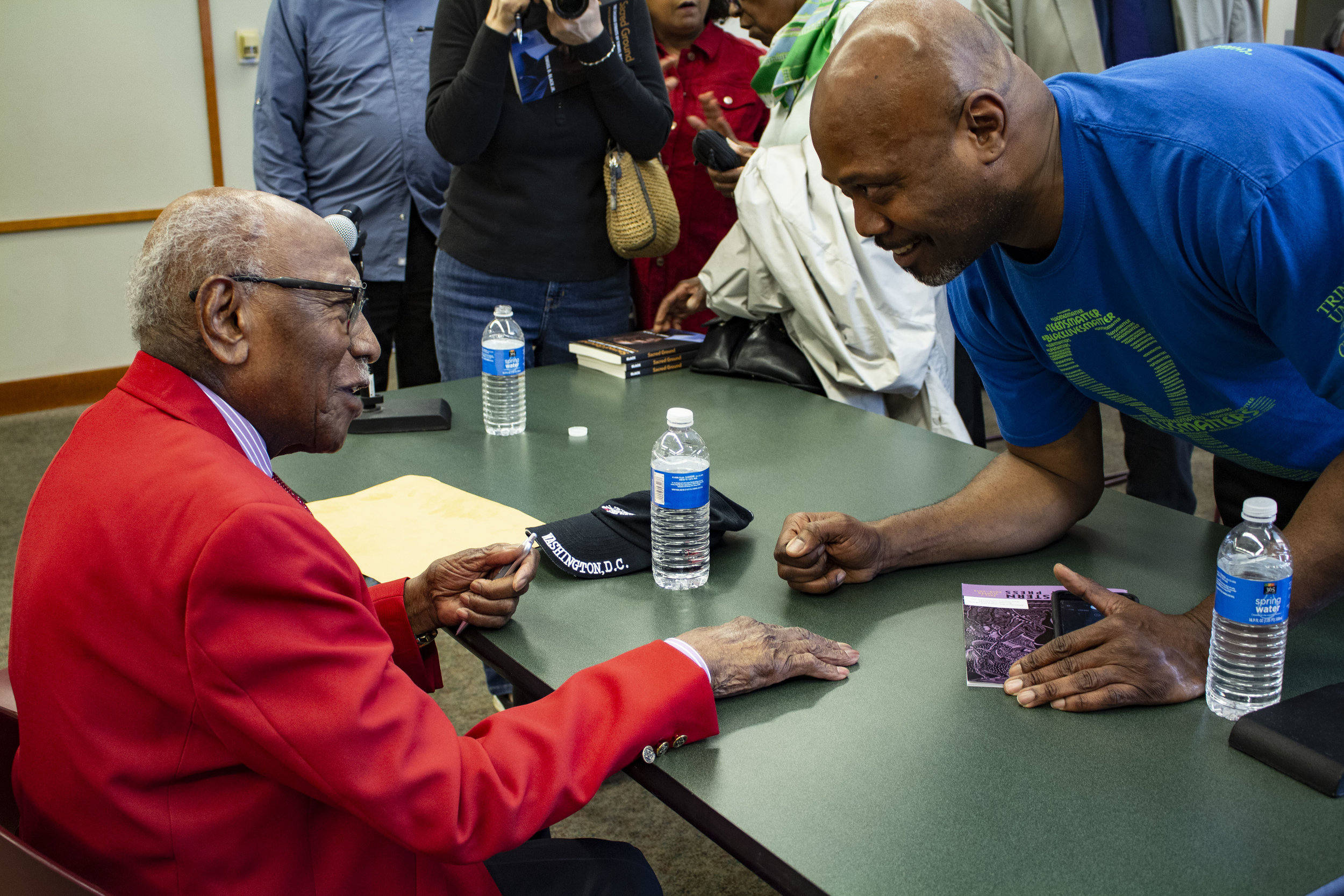 Timuel Black greets an attendee at the book signing following his event at Evanston Public Library.