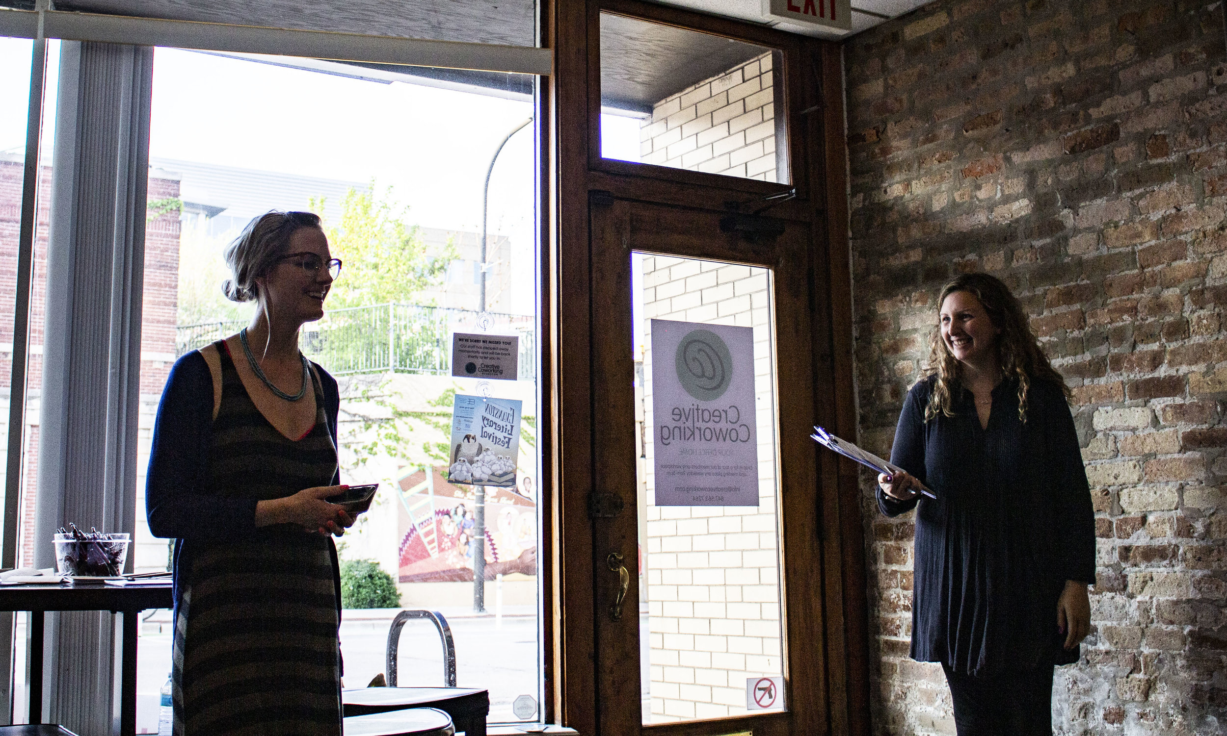 Sarah Ashley and Gina DiPonio introduce the Writer's Studio at the University of Chicago Graham School open mic at Creative Coworking.