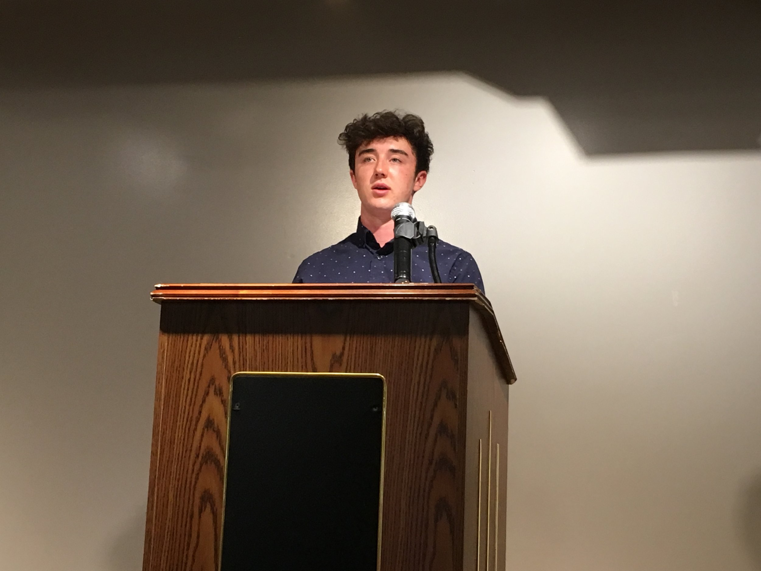 Foster Monroe reads at the Gibbs-Morrison Cultural Center.